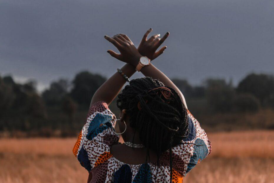 Black woman overlooking a field
